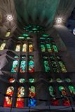 Geometric stained glass designs in Sagrada Familia window. Barcelona, Spain. Each unit is named after a person or place of religious significance and relevance stock image