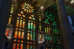Geometric stained glass designs in Sagrada Familia windows. Barcelona, Spain. Each unit is named after a person or place of religious significance and stock images