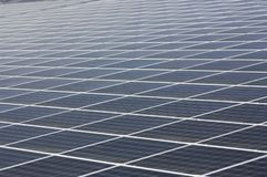 Geometric texture of solar panels at a photovoltaic plant. Closeup of some solar panels with geometric texture at a photovoltaic plant stock images