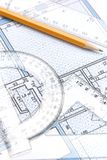 Geometric tools and a floor plan royalty free stock photos