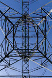 Geometric transmission tower from below. Geometric transmission tower with baby blue skies photo taken from below the tower looking towards the sky royalty free stock images
