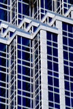 Geometrical building lines. A view of geometrical patterns and line created by the various windows and facade of a tall, modern building Royalty Free Stock Photography