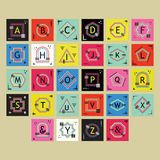 Geometrical colorful and trendy outline alphabets labels set. On beige background Royalty Free Stock Photo