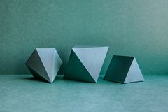 Geometrical figures still life composition. Three-dimensional prism pyramid tetrahedron rectangular cube objects on stock images