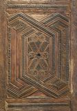 Geometrical and floral engraved patterns of Mamluk style wooden ornate door leaf royalty free stock photography