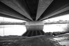 An abstract black and white long geometrical pattern of a bridge. Geometrical pattern consisting of huge constructial parts Royalty Free Stock Image