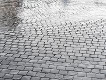 Geometrical pattern wet cobblestones. Geometrical pattern made of wet cobblestones Royalty Free Stock Photography