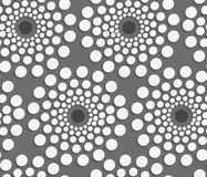Geometrical pattern with white dotted  concentric circles on gra Royalty Free Stock Photo