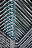 Geometrical superimposition of tubes. Geometrical superimposition of several chromium-plated and brilliant tubes stock photos
