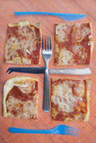 Geometries with pieces pizza and cutlery Royalty Free Stock Image