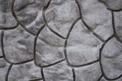 Geometrische dekorative Musterbeschaffenheit auf Zementbetonmauer Lizenzfreies Stockfoto