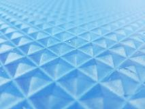 geometrische Zahlen in der blauen Beschaffenheit der Farbe 3d Stockfoto