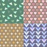 Geometrischer Vektormustersatz mit Sternen, Dreiecken und Herzen Lizenzfreie Stockbilder
