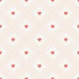 Geometrisches nahtloses Muster mit Raute und Herzen Stockbilder