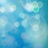 Geometrisk bakgrund för abstrakt blå bokeh med bubblor och triang Arkivfoto