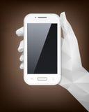 Geometrisk hand som rymmer Smartphone Arkivfoto