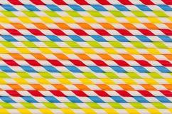 Geometrisk randig bakgrund för abstrakt mångfärgad regnbåge av drycksugrör Royaltyfri Foto