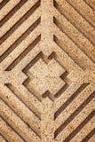 Geometriskt bilda i sten Arkivfoto