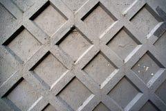 Geometriskt konkret staket Arkivfoto