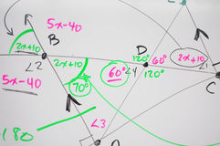 Geometry. Several complex mathematical formulas, equations, and geometry written on a white board Royalty Free Stock Photography