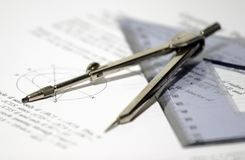 Geometry. Drawing compass, triangle and geometric papers Stock Image