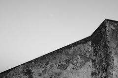 Geometry of building. Old concrete wall at sky background. Abstract architecture. White and black image. Geometry of building. Old concrete wall at sky Stock Photos