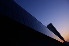 Geometry of the business center. Sunset in Dubai city Stock Photo