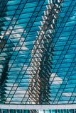 Geometry and lines of a modern business center. Clouds and buildings are reflected in the glass windows of the high-rise. Skyscraper of the modern commercial stock photo