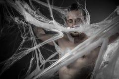 Geometry.man запутанное в огромной белой сети паука Стоковое Изображение