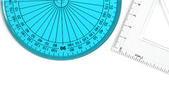 Geometry Set. Geometry items for school/design. Blue protractor and clear set square against white background. Copy space royalty free stock photo