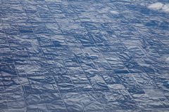 Geometry of Winter in the American Heartland, from 30,000 Feet Up. Snow grid of the American heartland, from a commercial airplane. There are clouds in the upper Stock Photos
