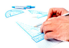 Geomtery set on paper with male hand and pen Royalty Free Stock Photos