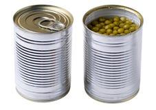 Geopend tin met groene geïsoleerde erwten stock fotografie