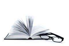 Geopende boek en glasses1 Stock Foto