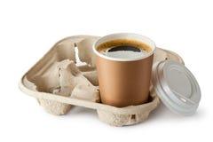 Geopende meeneemkoffie in houder Stock Foto's