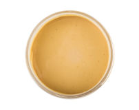 Geopende plastic die kruik met pindakaas op wit wordt geïsoleerd Royalty-vrije Stock Foto's