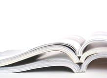 Geopende tijdschriften stock foto