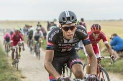Georg Preidler Riding on a Cobblestone Road - Tour de France 201 Stock Photo