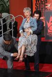 George Chakiris, Rita Moreno. George Chakiris with Rita Moreno  at the West Side Story Cast Hand and Footprint Ceremony, Chinese Theater, Hollywood, CA 11-15-11 Royalty Free Stock Photo