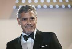 George Clooney deltar i den gigantiska `en för `-pengar, Arkivfoton