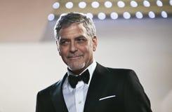 George Clooney deltar i den gigantiska `en för `-pengar, Royaltyfri Bild