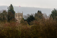 George cross flag above Bathampton, St. Nicholas church. Parish church a few miles from the city of Bath, in Somerset, UK Royalty Free Stock Images