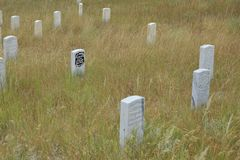 George Custer marker surrounded by his fallen men. Calvary men`s marker stones surround General George Custer`s marker where they died on the Little Bighorn stock photo