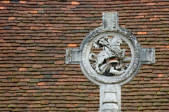 George and dragon. St george and dragon against a tiled roof background Stock Image