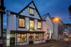 George & Dragon, Dartmouth at Night. The George & Dragon, Dartmouth at Night from Clarence Hill on the edge of the Conservation Area. Picture taken immediately stock photos