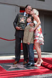 George Hamilton. & son GT, with girlfriend Barbara Strum at the Hollywood Walk of Fame ceremony bestowing a Star in his honor in Hollywood, CA on August 12 royalty free stock photography