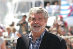George Lucas. CANNES, FRANCE - MAY 18: Writer George Lucas attends the Indiana Jones photocall at the Palais des Festivals during the 61st Cannes International royalty free stock photos