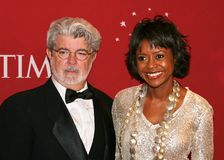 George Lucas and Mellody Hobson. Filmmaker George Lucas and wife, financial analyst and television personality Mellody Hobson, arrive on the red carpet at the royalty free stock photos