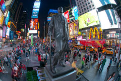 George M. Cohan Times Square. Statue of famed showman George M. Cohan and huge outdoor billboards promoting Broadway musicals in Times Square stock photography