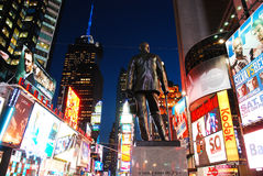 George M Cohan at Times Square. A statue of songwriter George M Cohan stands in the bustling Times Square Royalty Free Stock Images